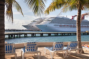 Two cruise ships docked at a Caribbean port