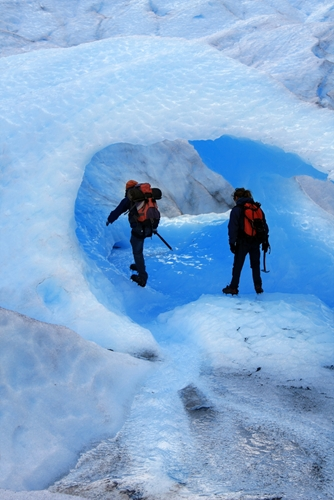 two men exploring ice cave