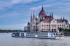 River cruise ship passing castle on European river