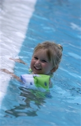 child in pool with floaties on