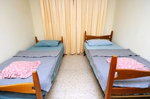 Room at hostel with two beds