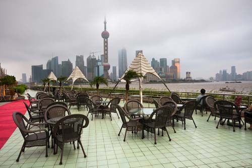 Rooftop restaurant bar in Shanghi overlooking the city skyline
